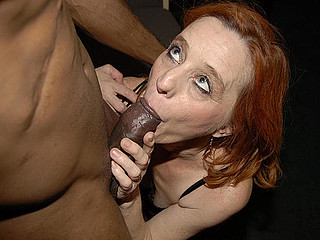 Red aged slut munching on a large black ramrod